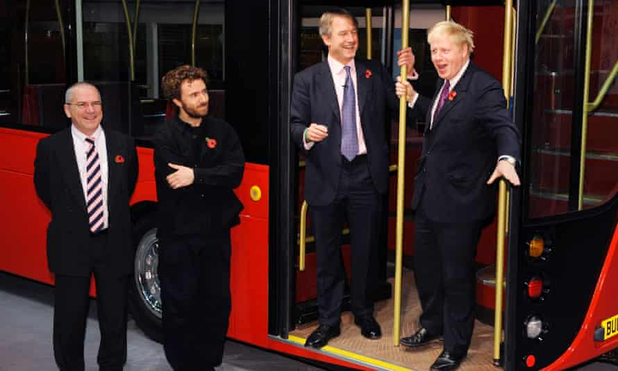 Mayor Boris Johnson unveils a life size mock up of the New Bus for London inspired by the old routemaster. For News. L to R; Unknown, Thomas Heatherwick, Owen Paterson (Secretary of State for Northern Ireland) and Boris Johnson Photo by Linda Nylind. 11/11/2010