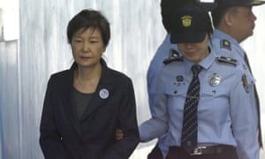 Former South Korean president Park Geun-hye arrives to attend a hearing at the Seoul central district court in Seoul