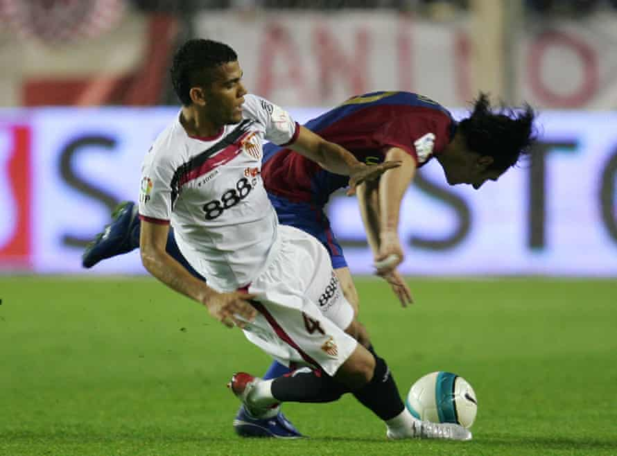 Dani Alves, seen here tackling Lionel Messi in 2003, told his manager at Sevilla, Joaquín Caparrós, that football has 'no limits, no rules' after being asked to stay in his own half.