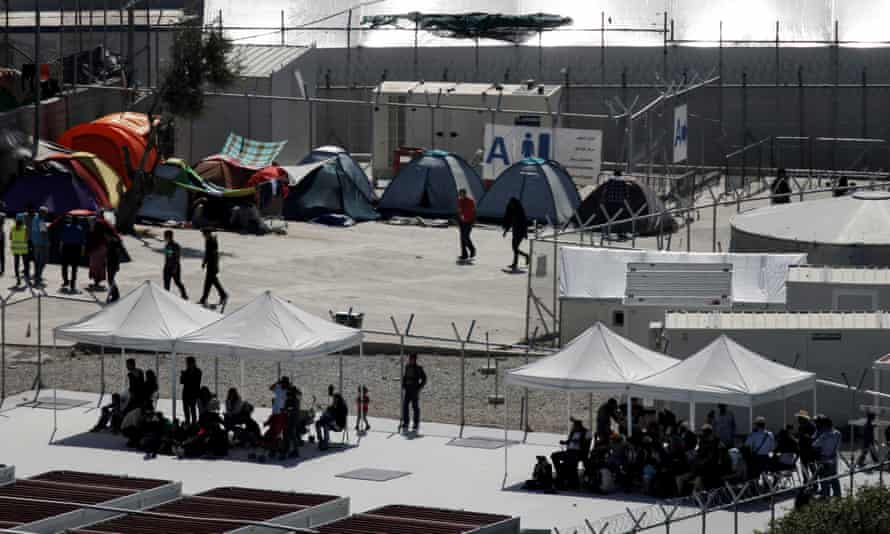 People are seen under tents inside the Moria holding centre on the Greek island of Lesbos.