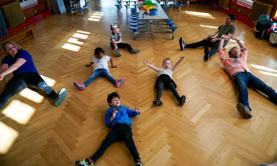 Children of key workers take part in a Joe Wicks exercise class at Oldfield Brow Primary School in Altrincham.