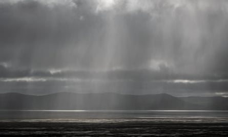A cold front brings heavy rain over Lake George near Canberra