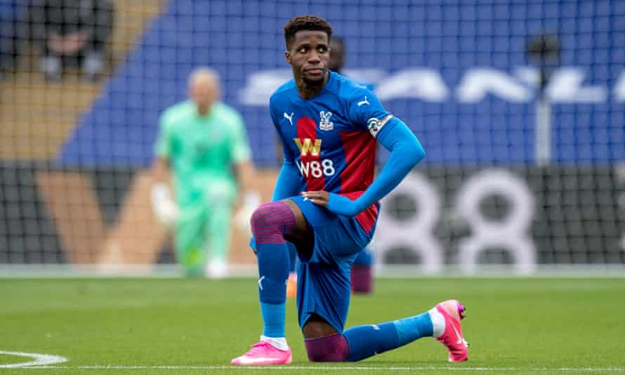 Wilfried Zaha take a knee before Crystal Palace's game against Everton in September.