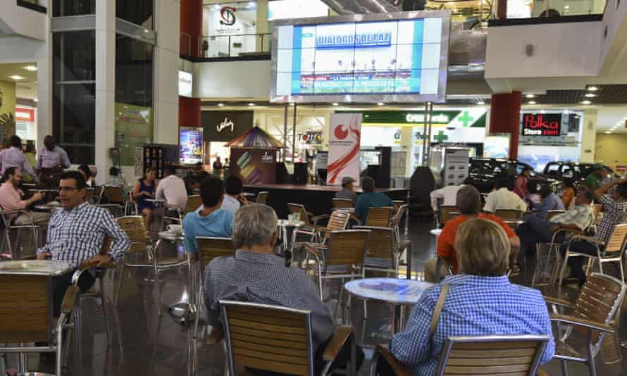 Colombians in Bogotá watch a telecast of the peace talks in Cuba on Wednesday.