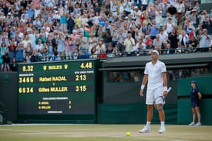 A stunned Gilles Muller stands in shock as he beats Rafael Nadal in a five set thriller
