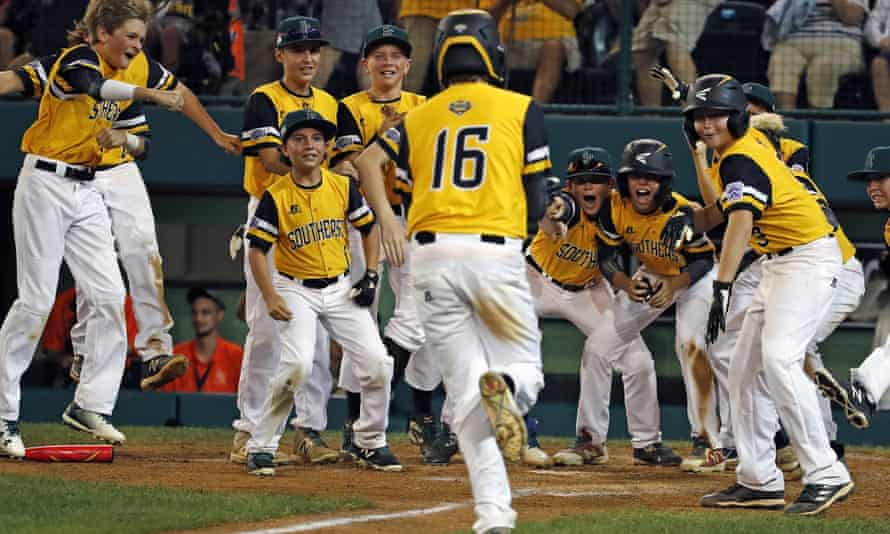 Georgia's Jansen Kenty  is greeted by teammates after hitting a home run at this year's Little League World Series