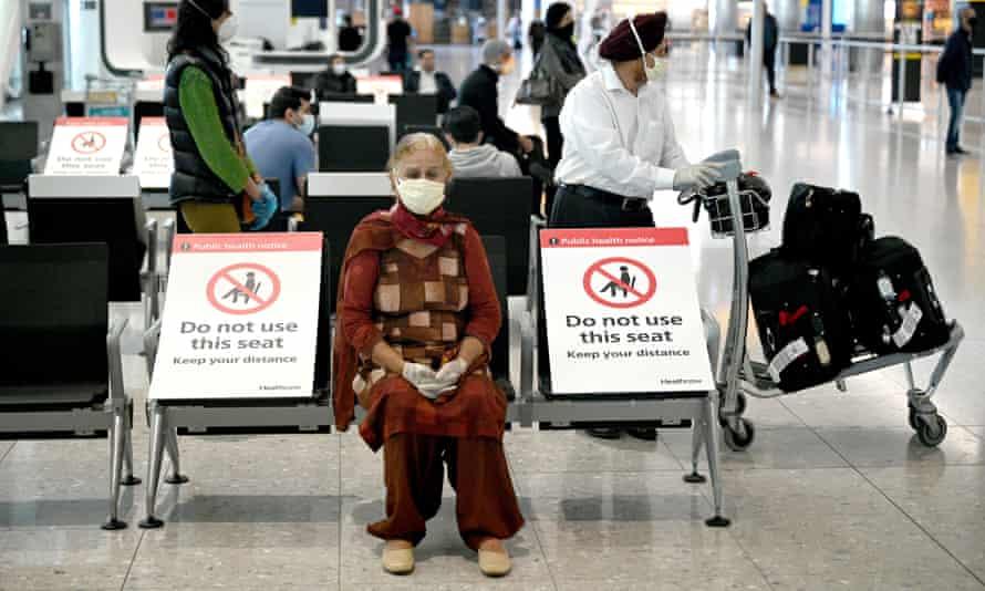 Passengers wearing masks arriving at Heathrow