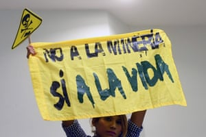 A protester at the legislative assembly in San Salvador holds a banner reading 'No to mining, yes to life'
