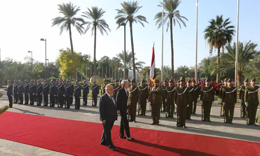 Abadi and May review the honour guard in Baghdad.