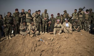 Kurdish Peshmerga fighters and commanders overlook Islamic State group positions during heavy fighting in Bashiqa, east of Mosul, Iraq