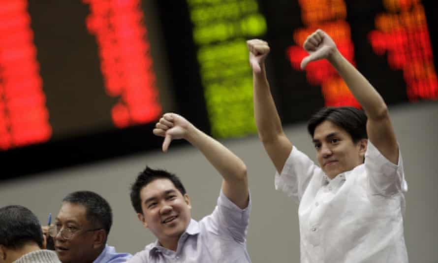 Traders give the thumbs down at a stock trading hub