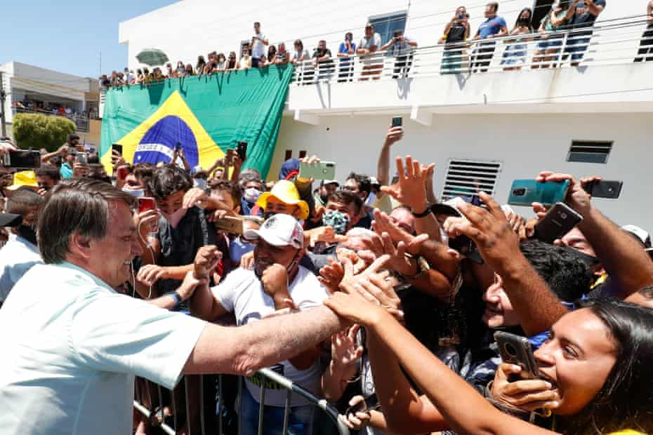 Jair Bolsonaro is greeted by supporters in Coremas, Paraiba state, Brazil, last month.