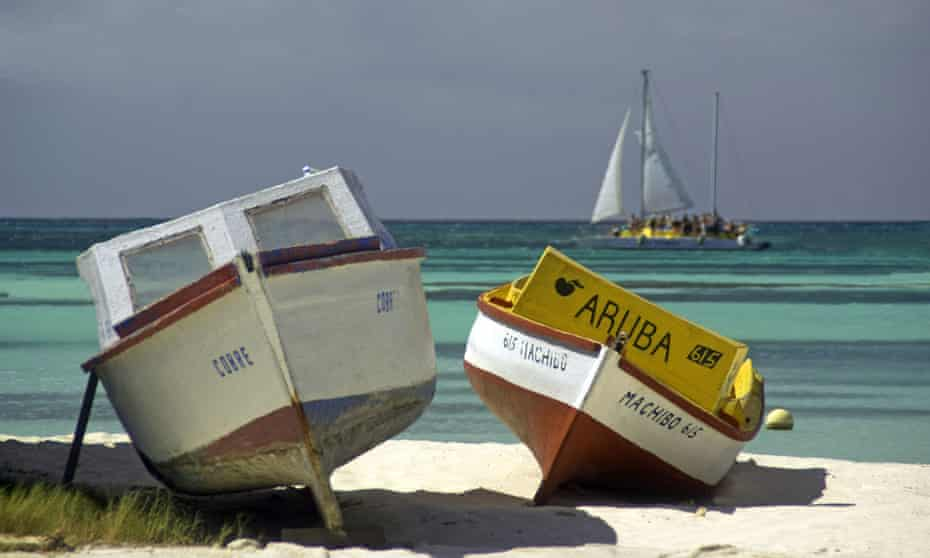 Aruba colourful boats on white sand beach