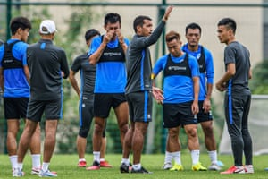 Guangzhou's head coach Giovanni van Bronckhorst takes a training session in April.