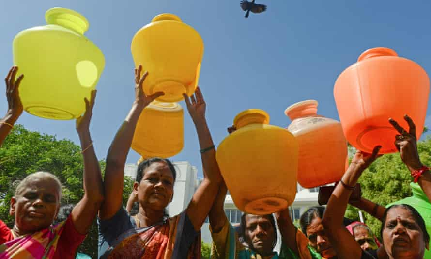Women with empty plastic pots protest as they demand drinking water in Chennai, India.