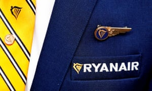 Ryanair logo is pictured on the the jacket of a cabin crew member