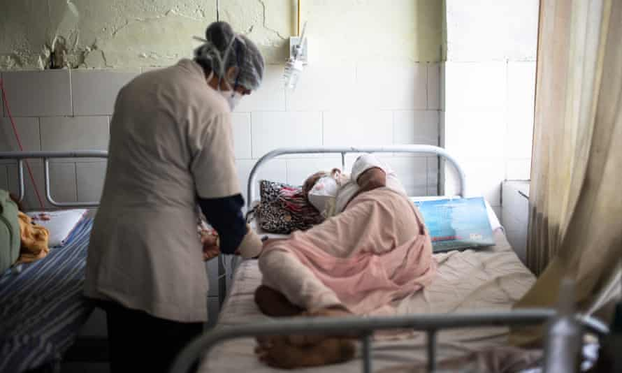 A nurse treats a patient suffering from mucormycosis in Jaipur, India