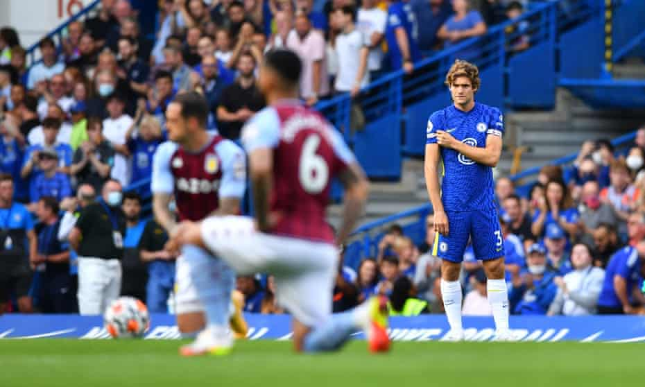 Chelsea's Marcos Alonso points to the 'no room for racism' message on the sleeve of his shirt before the match against Aston Villa this month.