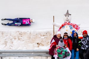Katharina Putzer of Italy competes in the second run of the women's luge singles as people pose for a photograph in St Mortitz.