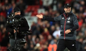 Jürgen Klopp gestures to a TV camera operator at Anfield.