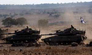 Israeli Merkava tanks take part in recent large-scale war games in the Golan Heights.