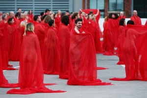 Participants pose as part of Spencer Tunick's art installation Return of the Nude in Melbourne