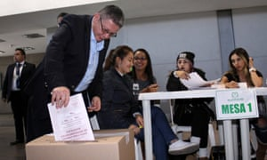 Pablo Catatumbo of the political party Farc deposits his vote during the legislative elections Monday in Bogota, Colombia.