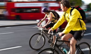 Two commuting cyclists in London.
