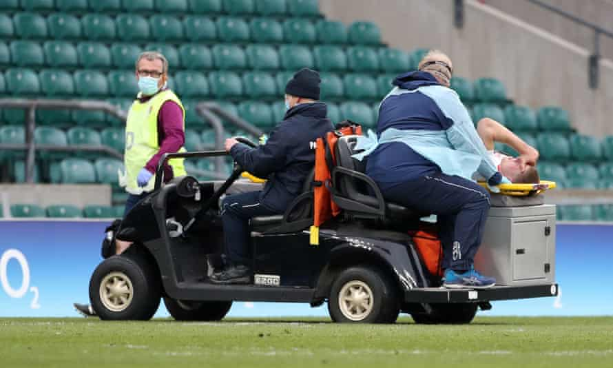 Jack Willis is taken off after sustaining the serious knee injury during England's win against Italy at Twickenham.