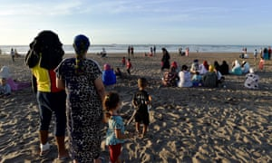 Moroccans wait on the beach last month in Casablanca  after a boat headed for Spain sank