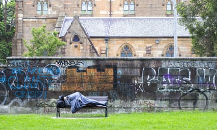 A homeless man sleeps on a park bench in Sydney in March. In response to coronavirus, state governments arranged for thousands of rough sleepers to access emergency accommodation.