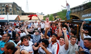 England fans watch the team's World Cup match against Tunisia at Flat Iron Square in London.