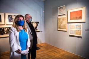 Slovakia's president, Zuzana Čaputová, left, and actor Martin Huba wear face masks as they visit the Slovak National Gallery in Bratislava