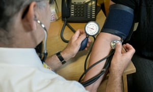 A GP takes a patients blood pressure