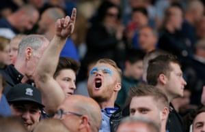 Once the fans are in the banter can begin as a home fan shouts towards the away support.