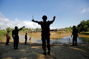 Members of BGB command to the Rohingya people not to cross the canal