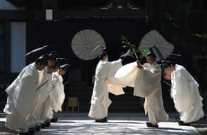 Priests prepare to perform a Shinto ritual during the three-day spring festival at the shrine in Tokyo on April 22, 2018.