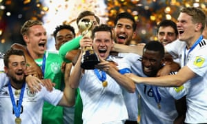 Germany celebrate with the Confederations Cup trophy after beating Chile 1-0 in St. Petersburg.