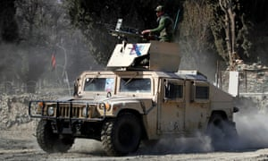 An armored vehicle patrols near the site where two US soldiers were killed in Shirzad district of Nangarhar province on 9 February. On Friday a vehicle carrying civilians was targeted in an airstrike in the province.