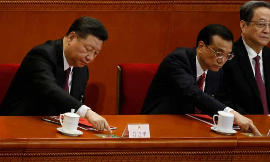 Chinese President Xi Jinping and Premier Li Keqiang press buttons to vote during the first session of the 13th National People's Congress (NPC) at the Great Hall of the People in Beijing, China.