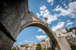 Mostar, Bosnia and Herzegovina: Genevieve Bradley of the US dives from the 21-metre platform on Stari Most during the first training session of the sixth stop of the Red Bull Cliff Diving World Series