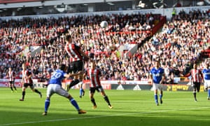 Chris Basham leaps to power Sheffield United in front against Ipswich at Bramall Lane.