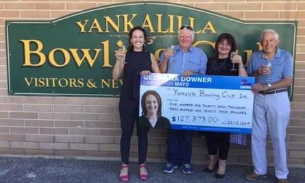 Georgina Downer hands a cheque to the Yankallila bowling club