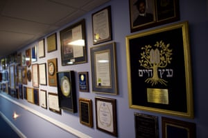 Another wall of awards and certificates for speaking engagements
