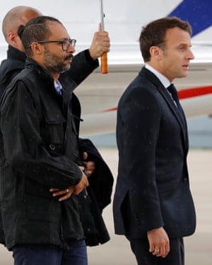 French hostage Laurent Lassimouillas with Emmanuel Macron (r).