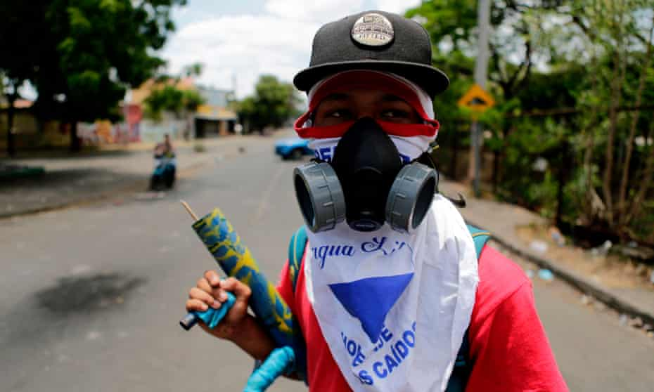 A student carrying a makeshift mortar is pictured at Nicaragua's Polytechnic University, during protests against Daniel Ortega's government in Managua on Wednesday.