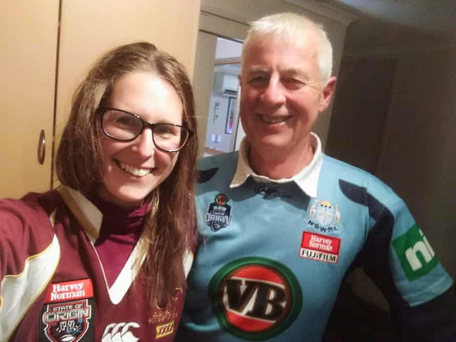 The couple wear NSW and Queensland jerseys for a State of Origin match in 2014