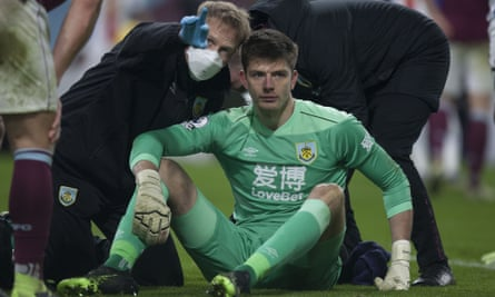 Burnley's goalkeeper Nick Pope goes through the concussion protocol with medical staff after a blow to the head in Monday's game with Crystal Palace.