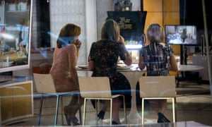Hoda Kotb, Savannah Guthrie and Dylan Dreyer sit at a table during a break on the set of NBC's Today Show, Wednesday in New York City.
