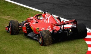 Ferrari's Sebastian Vettel kicks up grass after spinning during qualifying at Suzuka.
